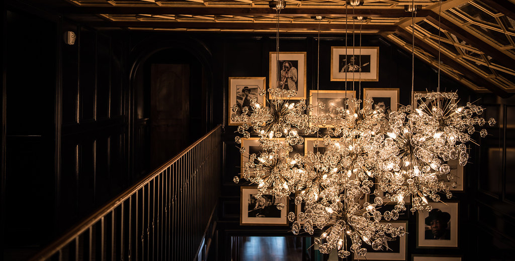 Stunning chandelier hangs above the upstairs balcony